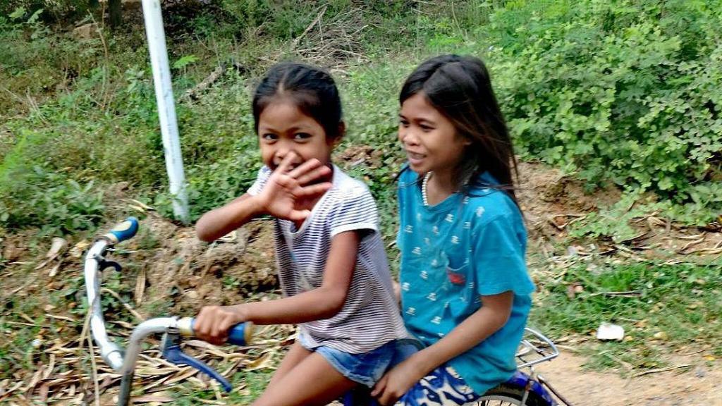 Le sourire des enfants à vélo